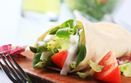 tortilla: Tortilla filled with fresh vegetables Stock Photo