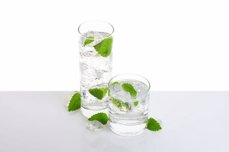 seltzer: glasses of fizzy water with mint and ice