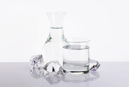 seltzer: carafe and glass of fresh water with ice