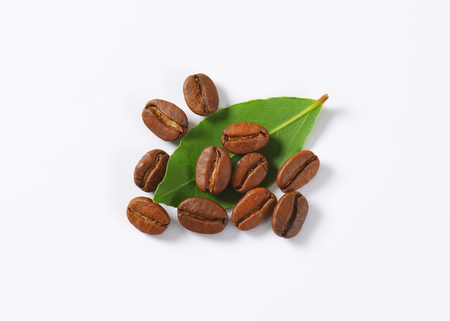 fairtrade: Handful of roasted coffee beans on white background Stock Photo