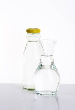 seltzer: glass bottle and carafe of fresh water Stock Photo