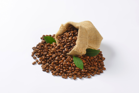 fairtrade: Roasted coffee beans in a burlap sack