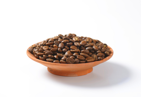 fairtrade: Medium roasted coffee beans in terracotta bowl