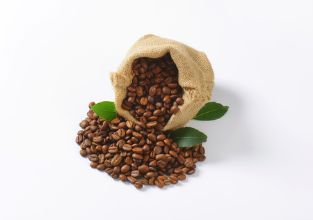burlap sack: Roasted coffee beans in a burlap sack