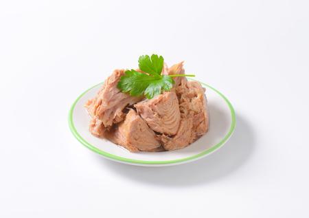 chunks: chunks of canned tuna on white plate