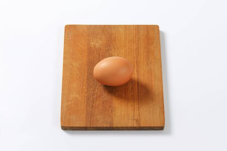 cutting: egg on wooden cutting board