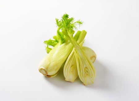 bulb and stem vegetables: fresh fennel bulbs on white background