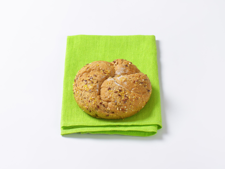 place mat: fresh bread bun on green place mat Stock Photo