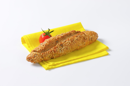 bread roll: fresh bread roll and cherry tomato on yellow place mat
