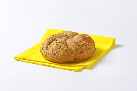 place mat: fresh bread bun on yellow place mat