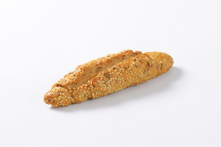 bread roll: fresh bread roll with seeds on white background