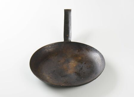 skillet: empty black skillet on white background