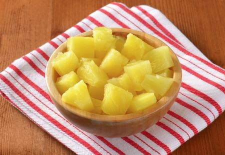 dishcloth: bowl of pineapple pieces on striped dishtowel