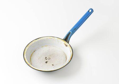 skillet: old skillet on white background