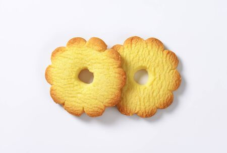 two italian butter cookies Canestrelli on white background