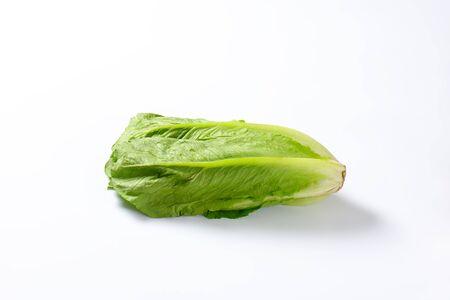 romaine lettuce: head of romaine lettuce on white background