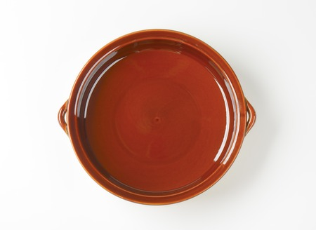 empty casserole dish on white background