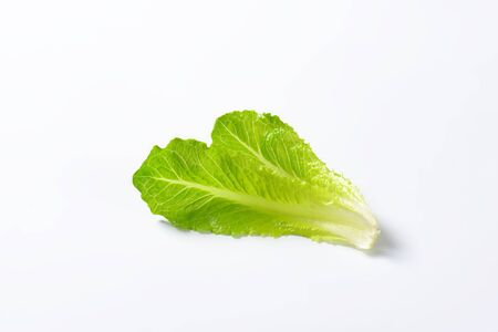 romaine: two leaves of romaine lettuce on white background