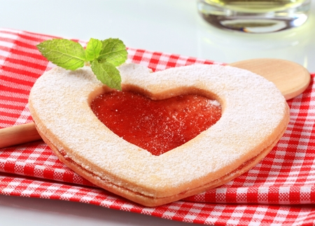 strawberry jam sandwich: Heart shaped  Linzer cookie with jam filling