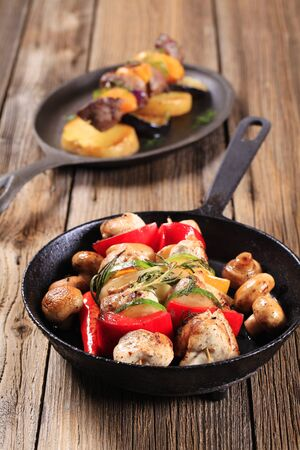 cast iron: Chicken shish kebabs on a cast iron skillet