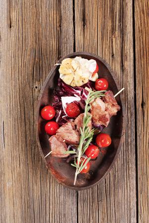 shish kebab: Shish kebab with garlic and cherry tomatoes Stock Photo