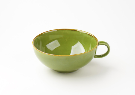 green tea cup: empty green tea cup on white background Stock Photo