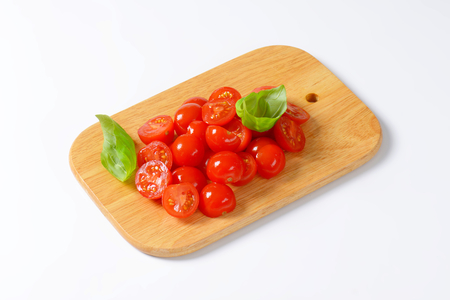 halved: Halved cherry tomatoes on cutting board