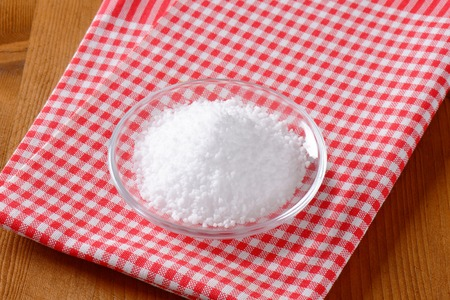 grained: Coarse grained edible salt on small glass plate
