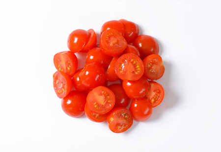 halved: heap of halved cherry tomatoes