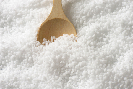 coarse: Detail of coarse grained salt and wooden spoon Stock Photo