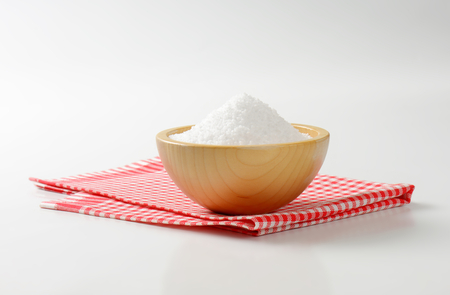 grained: Coarse grained salt in wooden bowl