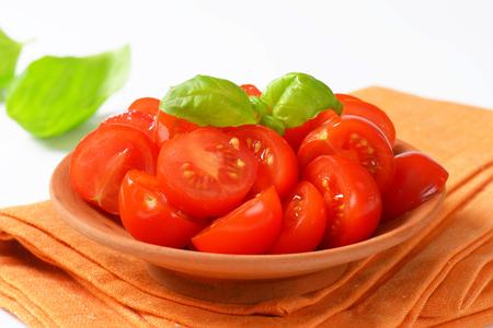 halved  half: bowl of fresh halved cherry tomatoes