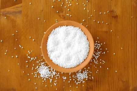 grained: Coarse grained salt in terracotta bowl