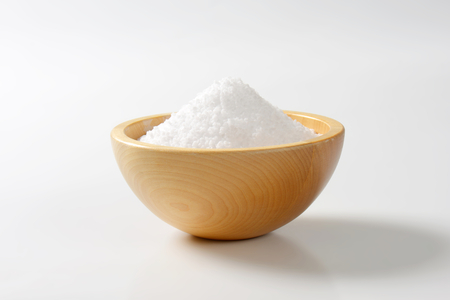 Coarse grained salt in wooden bowl