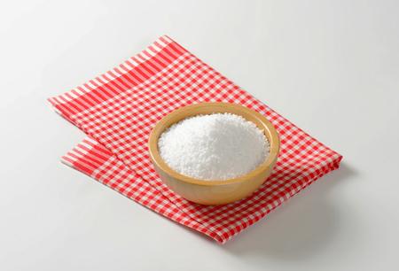 Coarse grained salt in wooden bowl
