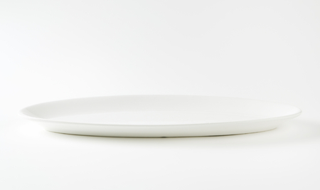 rimless: Oval plain white serving plate