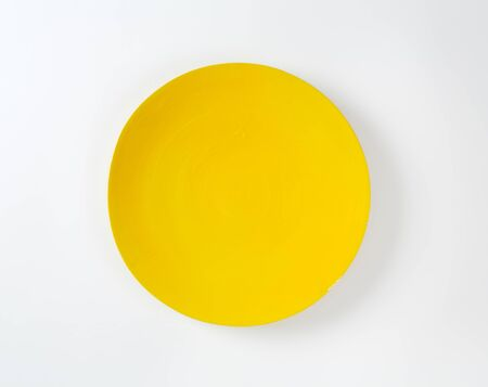 rimless: Rimless round plate with yellow glaze