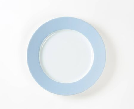 plate: white plate with blue rim on white background