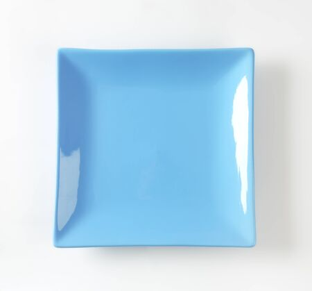 plate: blue square plate on white background