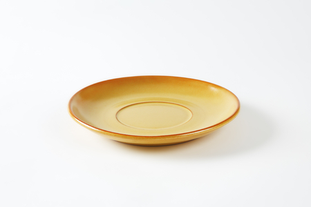 empty orange saucer on white background
