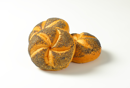 poppy seeds: Bulkie rolls topped with poppy seeds Stock Photo