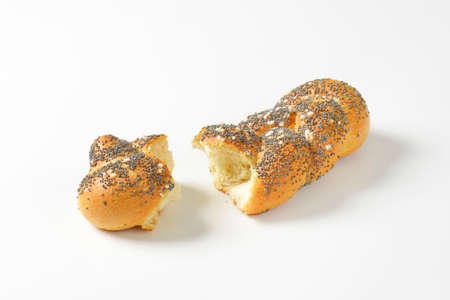braided: Pieces of braided poppy seed bread roll