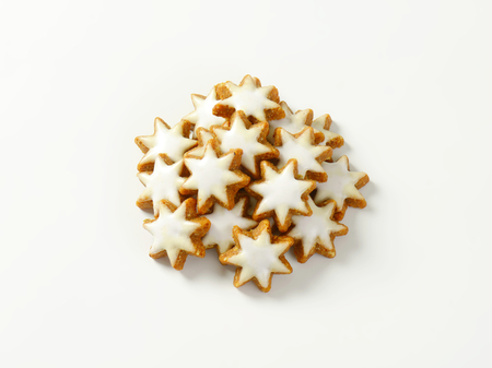 heap of christmas star cookies on white background stock photo 45461456