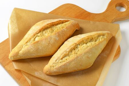 crusty french bread: White sourdough bread rolls with crispy crust Stock Photo