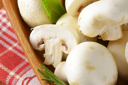 button mushrooms: Fresh button mushrooms in square wooden bowl Stock Photo