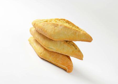 crusty: Three diamond-shaped crusty dinner rolls