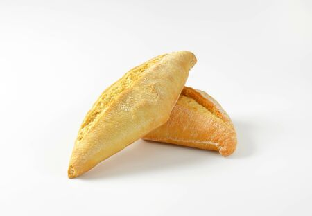 crusty french bread: Plain crusty bread rolls on white background Stock Photo