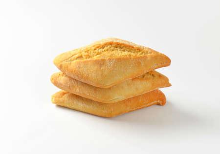 crusty french bread: Three stacked white crusty rolls