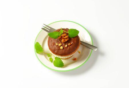 glaze: Nut muffin with chocolate glaze