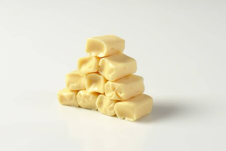 chewy: Stack of caramel-like white chewy candies